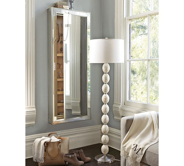 Organize your jewelry and optimize the use of space with this beautiful Pottery Barn wall mounted jewelry storage cabinet.
