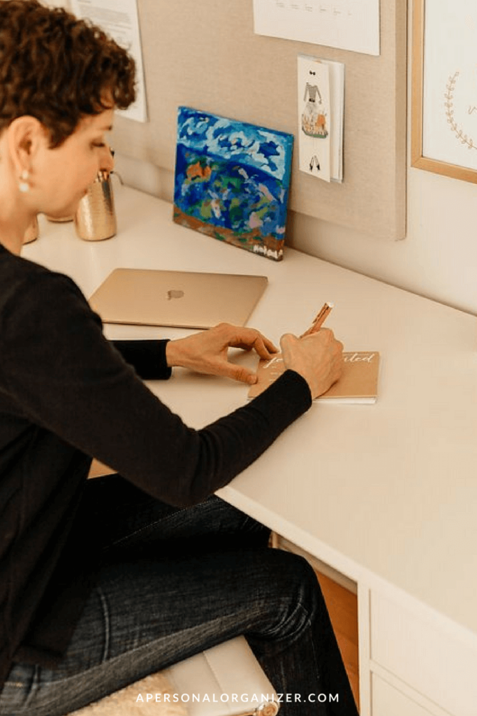 Woman Writing a Thank You Card - A Personal Organizer