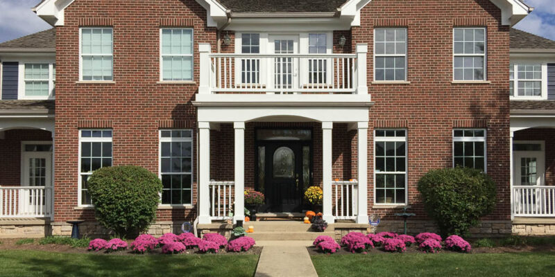 Brick House with White Trim & front flowery garden - A Personal Organizer
