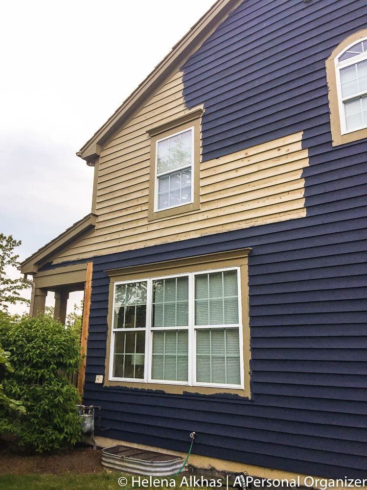 side of house being painted with Hale Navy by Benjamin Moore