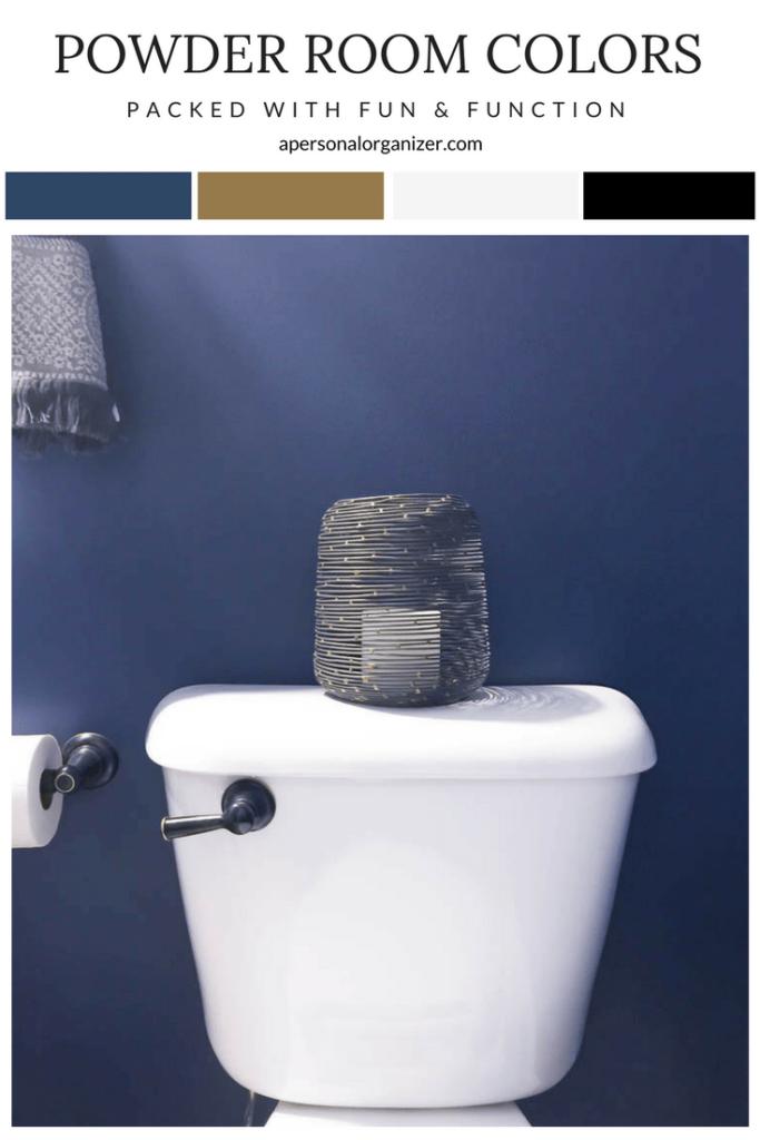 a white toilet tank with rubbed oil bronze flush handle against a Indigo Batik navy wall