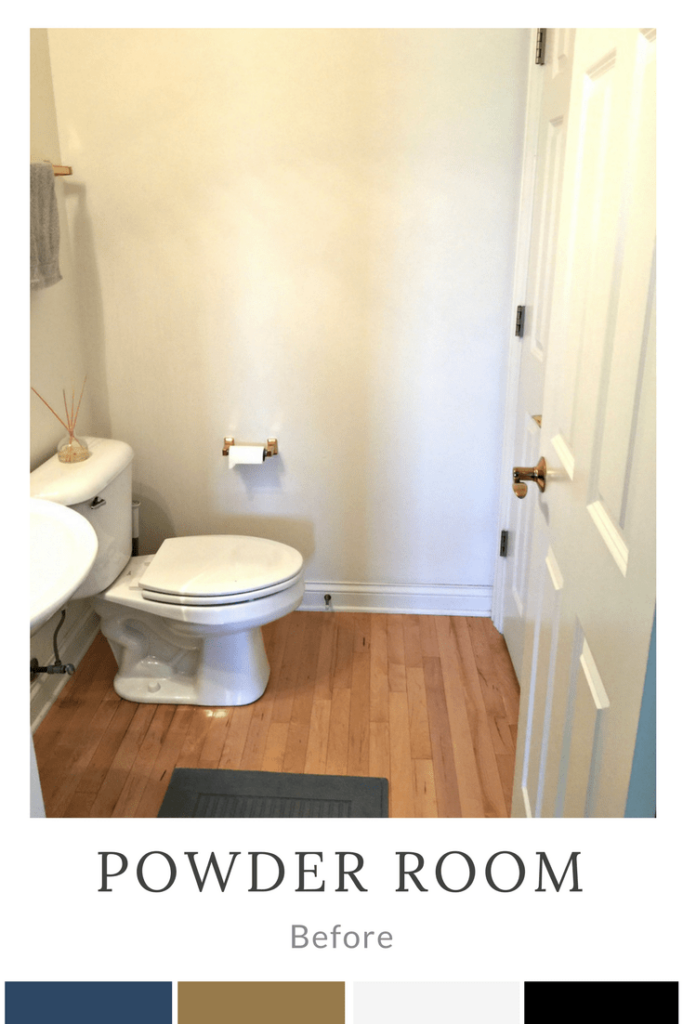small bathroom with white walls and gold fixtures.