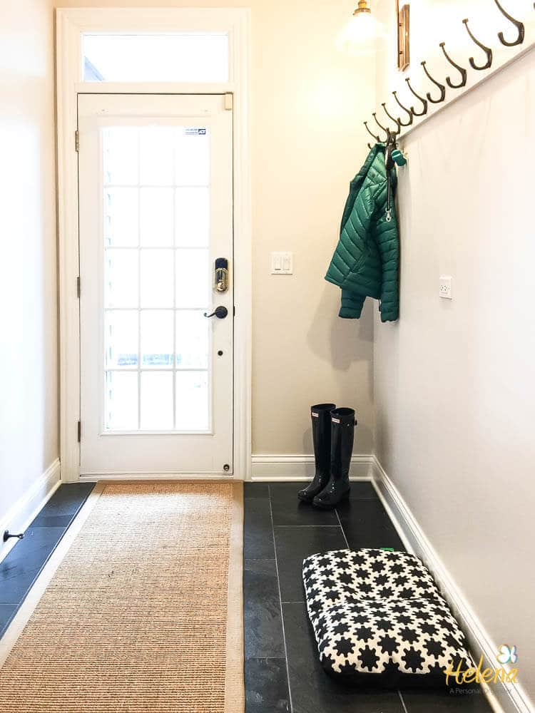 Mudroom with external door and hooks on wall