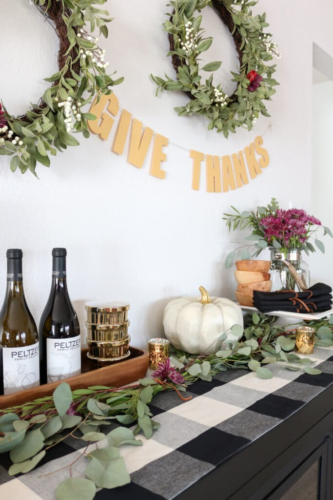 "Gold ""Give Thanks"" banner above a festive table"