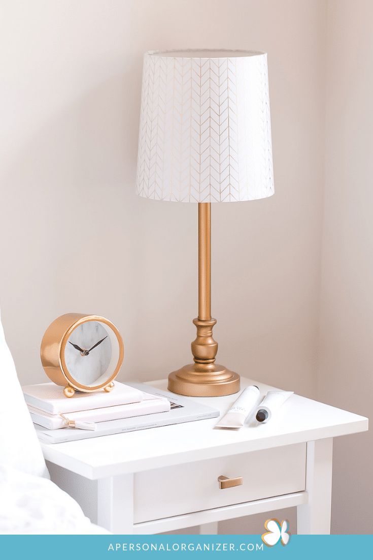 white nightstand with gold accessories