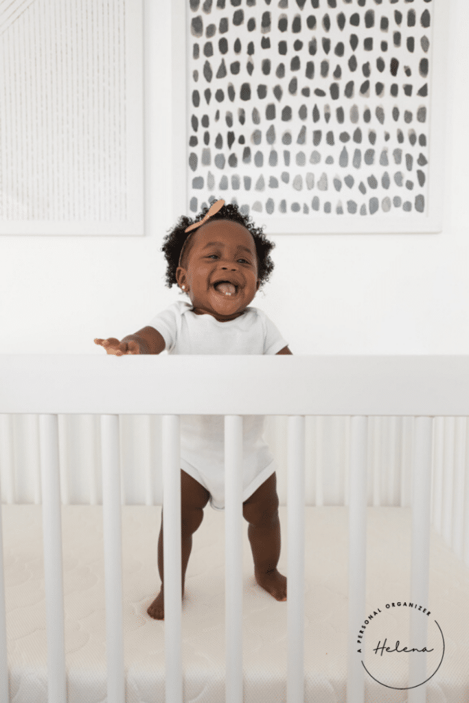 happy baby jumping in her crib